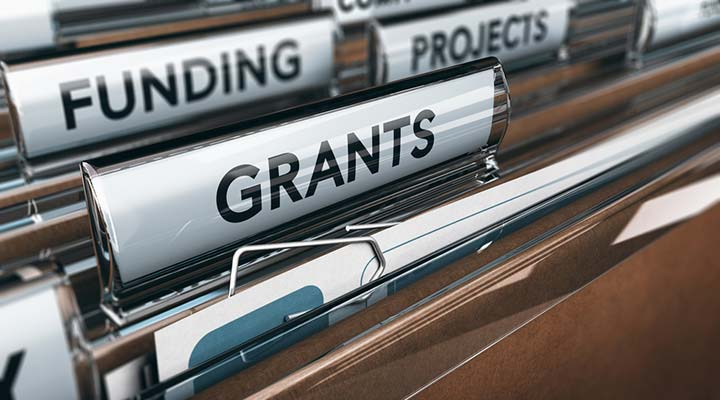 Community Fund; Grants, Funding and Projects tabs in a paper filing system