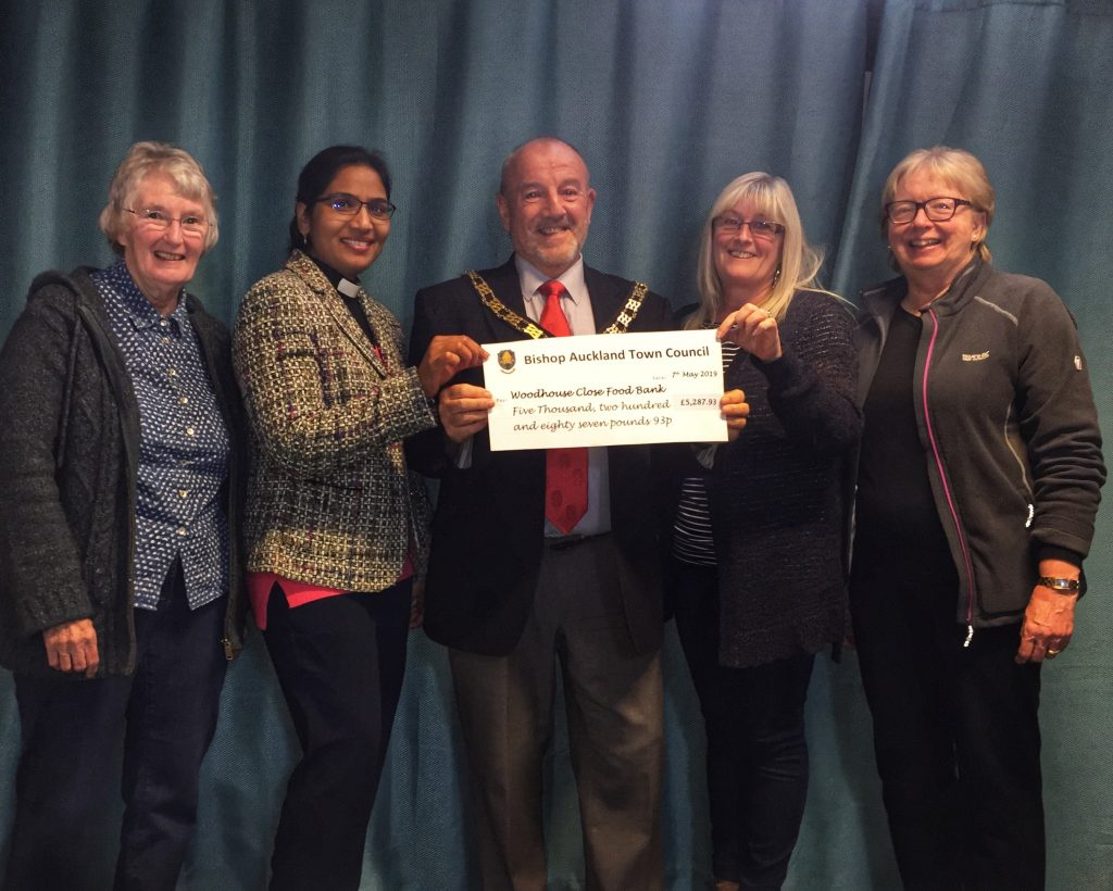 Mayor David Fleming presenting end of Mayoral year donation of £5287.93 to Woodhouse Close Community Foodbank