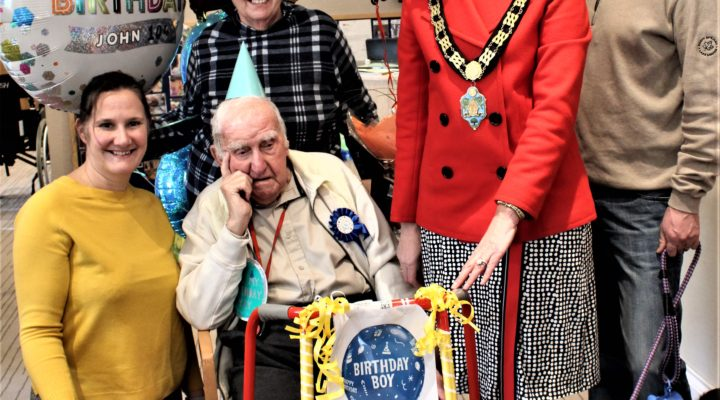 John celebrating his 104th Birthday with his daughter and family members