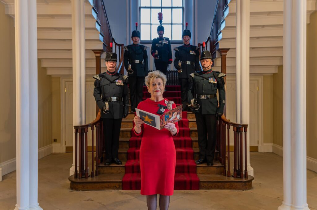 Her Majesty's Lord Lieutenant of County Durham Mrs Sue Snowdon, reading Santa Bells in the Gentleman's Hall of Auckland Castle with the fanfare of Bells from the 8th Rifles.