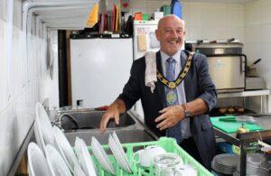 Councillor Dave Fleming washing up